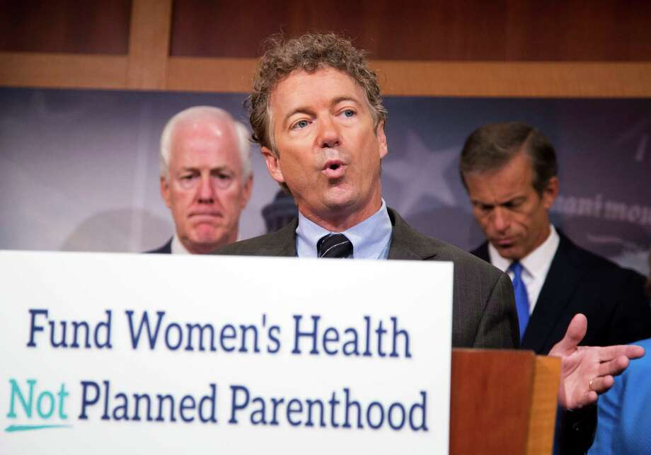 Sen. Rand Paul, R-Ky., with Sens. John Cornyn and John Thune, speaks about Planned Parenthood on Capitol Hill in Washington on July 29. Photo: Manuel Balce Ceneta / Associated Press / AP