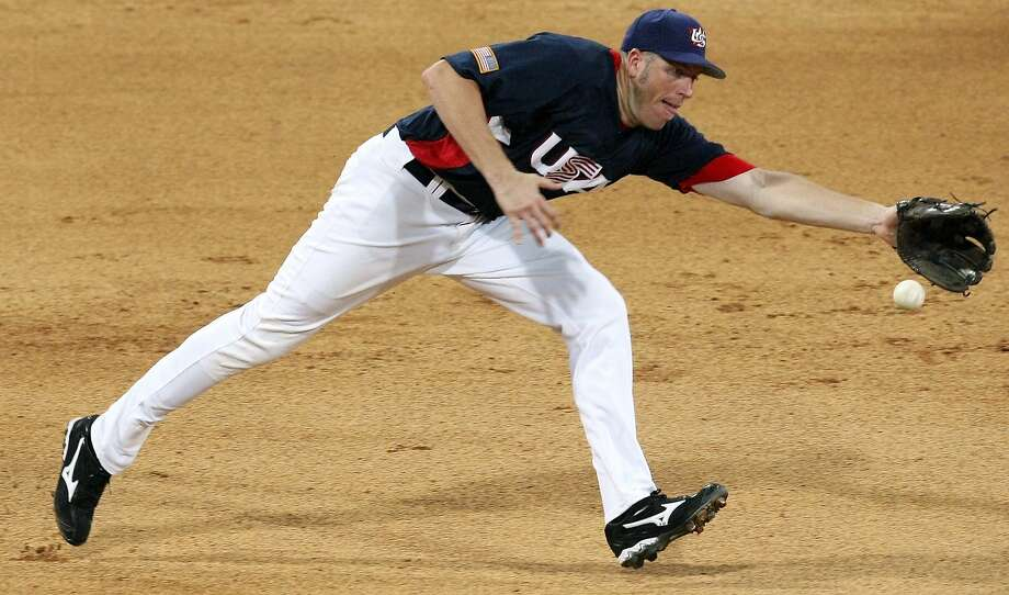 FOR SPORTS - USA's Mike Hessman fields a ball against Korea during their preliminary game at the 2008 Beijing Olympics Wednesday Aug 13, 2008 in Beijing, China. Korea won 8-7. (PHOTO BY EDWARD A. ORNELAS/eornelas@express-news.net) Photo: Edward A. Ornelas, Eornelas@express-news.net