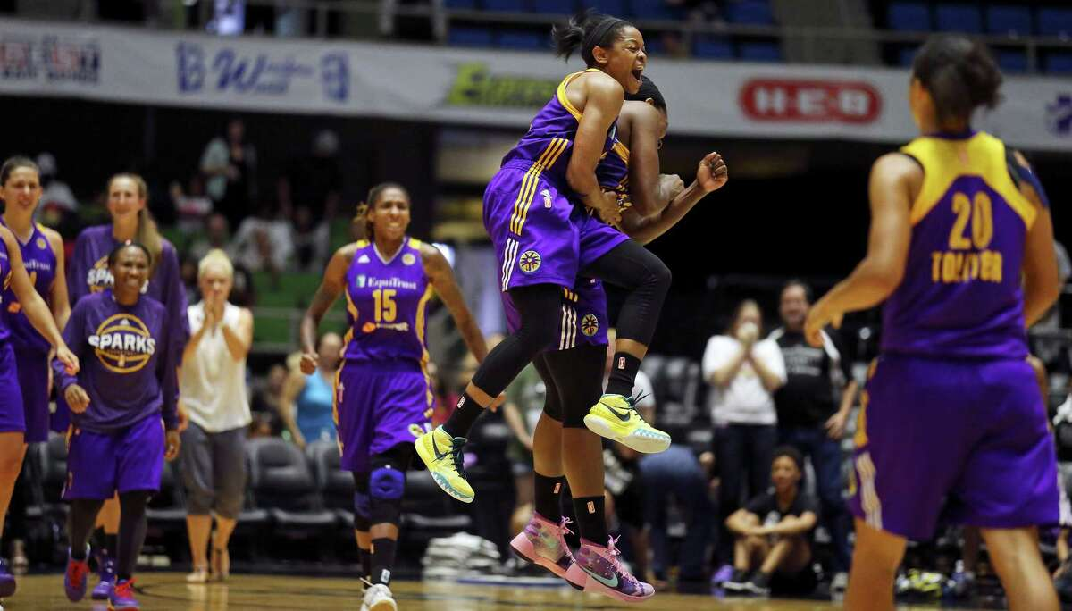 Los Angeles Sparks' Alana Beard (center left) and teammate Jantel Lavender celebrate after defeating the San Antonio Stars 80-78 Sunday Aug. 2, 2015 at the Freeman Coliseum.