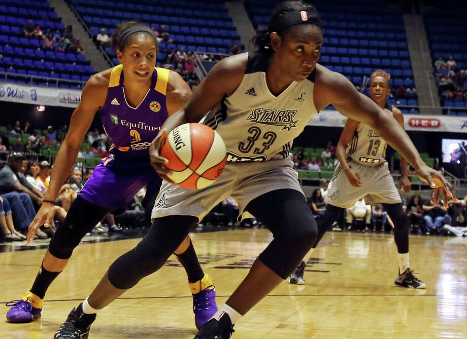 San Antonio Stars' Sophia Young-Malcolm drives to the basket around Los Angeles Sparks' Candace Parker during first half action Sunday Aug. 2, 2015 at the Freeman Coliseum. Photo: Edward A. Ornelas /San Antonio Express-News / © 2015 San Antonio Express-News