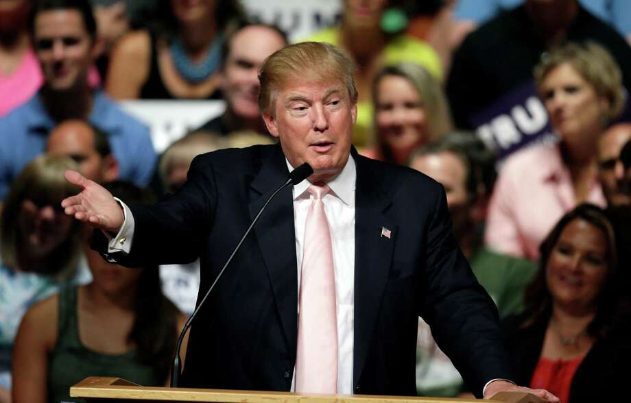 Donald Trump, speaking July 25 in Oskaloosa, Iowa, is widely believed to be the wealthiest American ever to run for president.  Photo: Charlie Neibergall, STF / AP