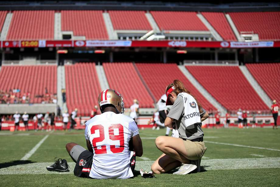 Safety Jaquiski Tartt gets some medical attention from the training staff before 49ers practice in Santa Clara, California, on Sunday, Aug. 2, 2015. Photo: Connor Radnovich, The Chronicle