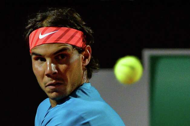 Rafael Nadal of Spain eyes the ball as he plays against Stan Wawrinka of Swiss during their ATP Tennis Open match in Rome on May 15, 2015 in Rome. AFP PHOTO / ANDREAS SOLAROANDREAS SOLARO/AFP/Getty Images ORG XMIT: 1364 Photo: ANDREAS SOLARO / AFP