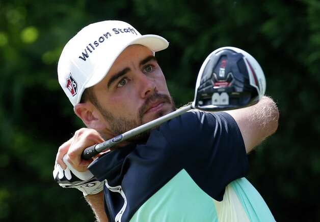 Troy Merritt watches his tee shot on the third hole during the final round of the Quicken Loans National golf tournament at the Robert Trent Jones Golf Club in Gainesville, Va., Sunday, Aug. 2, 2015. (AP Photo/Steve Helber) ORG XMIT: VASH108 Photo: Steve Helber / AP