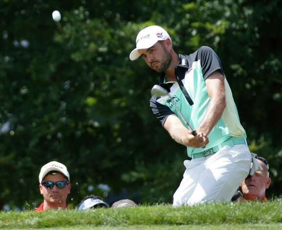 Troy Merritt hits up to the second green during the final round of the Quicken Loans National golf tournament at the Robert Trent Jones Golf Club in Gainesville, Va., Sunday, Aug. 2, 2015.  (AP Photo/Steve Helber) ORG XMIT: VASH114 Photo: Steve Helber / AP