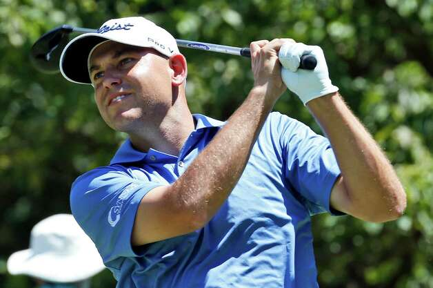 Bill Haas watches his tee shot on the second hole during the final round of the Quicken Loans National golf tournament at the Robert Trent Jones Golf Club in Gainesville, Va., Sunday, Aug. 2, 2015. (AP Photo/Steve Helber) ORG XMIT: VASH110 Photo: Steve Helber / AP