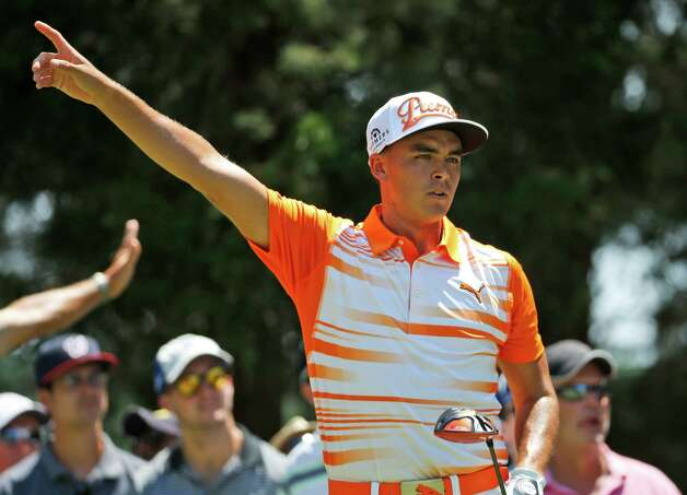 Rickie Fowler warns fans of an errant tee shot on the third hole during the final round of the Quicken Loans National golf tournament at the Robert Trent Jones Golf Club in Gainesville, Va., Sunday, Aug. 2, 2015.  (AP Photo/Steve Helber) ORG XMIT: VASH113 Photo: Steve Helber / AP