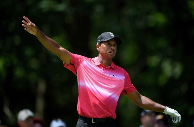 Tiger Woods reacts to his tee shot on the eighth hole during the final round of the Quicken Loans National golf tournament at the Robert Trent Jones Golf Club in Gainesville, Va., Sunday, Aug. 2, 2015. (AP Photo/Nick Wass) ORG XMIT: VANW106 Photo: Nick Wass / FR67404 AP