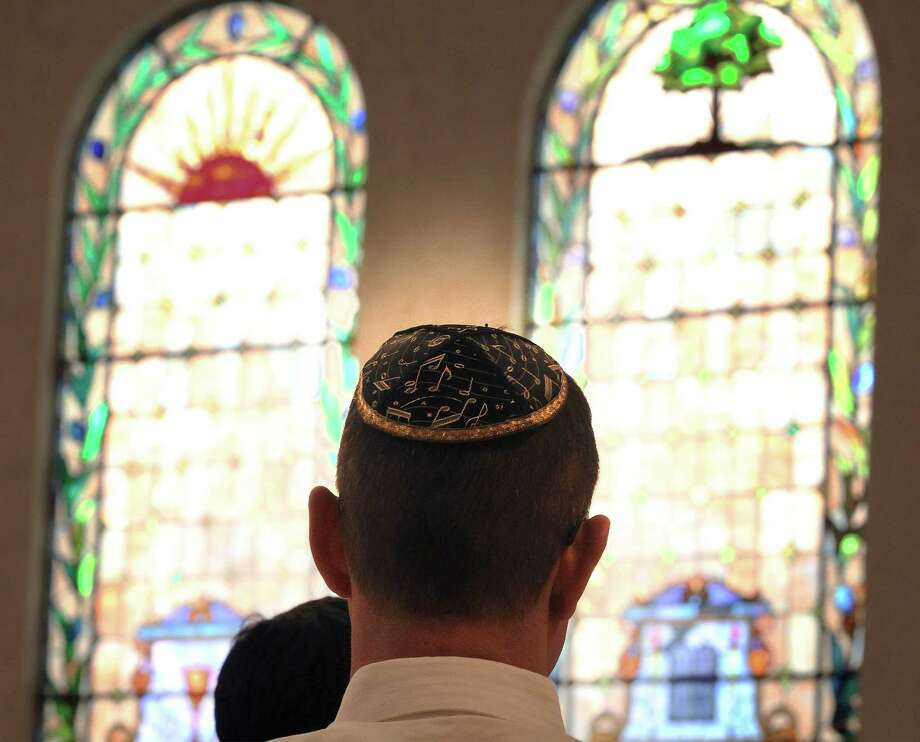 A choir member wears a music-inspired yarmulke during the Rosh Hashanah service at Temple Beth-El on Sept. 24, 2014. A congregation gathered at the synagogue to mark the start of Jewish High Holy Days. Photo: Kin Man Hui /San Antonio Express-News / ©2014 San Antonio Express-News