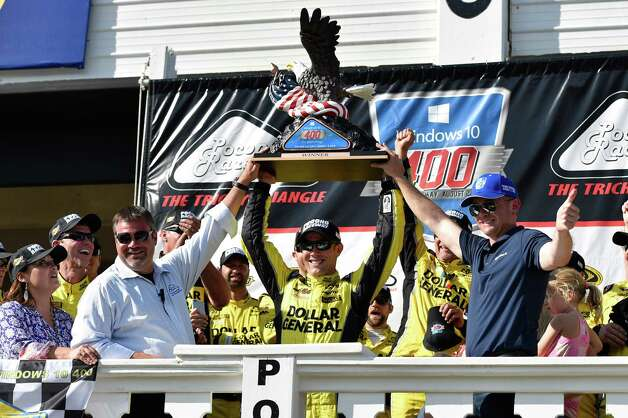 Matt Kenseth, center, celebrates in Victory Lane with the trophy after winning the NASCAR Pocono 400 auto race, Sunday, Aug. 2, 2015, in Long Pond, Pa. (AP Photo/Derik Hamilton) ORG XMIT: PADH102 Photo: Derik Hamilton / FR170553 AP