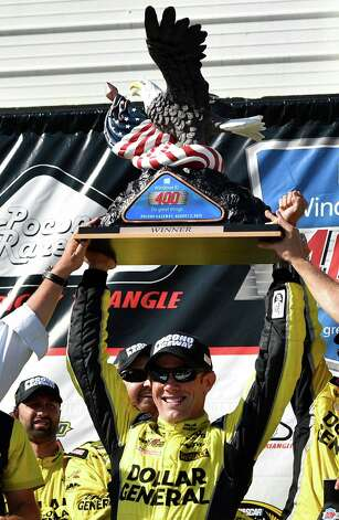 Matt Kenseth celebrates in Victory Lane with the trophy after winning the NASCAR Pocono 400 auto race, Sunday, Aug. 2, 2015, in Long Pond, Pa. (AP Photo/Derik Hamilton) ORG XMIT: PADH103 Photo: Derik Hamilton / FR170553 AP