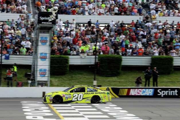 Matt Kenseth crosses the finish line to win the NASCAR Pocono 400 auto race, Sunday, Aug. 2, 2015, in Long Pond, Pa. (AP Photo/Matt Slocum) ORG XMIT: PAMS105 Photo: Matt Slocum / AP