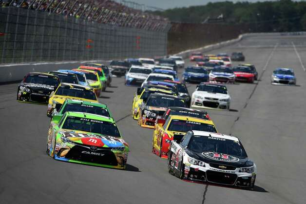 Kyle Busch (18) and Kevin Harvick (4) lead the field into Turn 1 during the NASCAR Pocono 400 auto race, Sunday, Aug. 2, 2015, in Long Pond, Pa. (AP Photo/Derik Hamilton) ORG XMIT: PADH101 Photo: Derik Hamilton / FR170553 AP