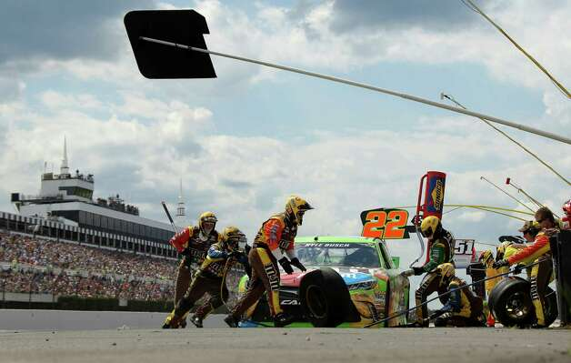 Crew members work on the car of Kyle Busch during a pitstop during the NASCAR Pocono 400 auto race, Sunday, Aug. 2, 2015, in Long Pond, Pa. (AP Photo/Matt Slocum) ORG XMIT: PAMS103 Photo: Matt Slocum / AP
