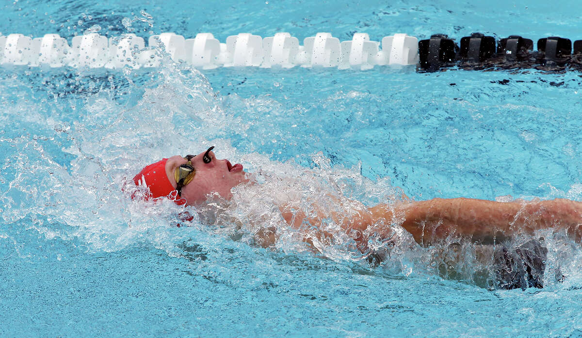 Josh Artmann competes in the men's 200-meter backstroke during the 2015 Speedo Junior National Championships held Friday July 31, 2015 at the Northside Swim Center. Artmann finished in second place with a time of 2:01.23. Austin Katz finished in first place with a time of 1:59.14. David Crossland finished in third place with a time of 2:01.52.