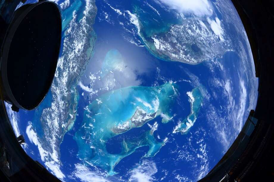 The following photos were shot by U.S. Astronaut Scott Kelly from aboard the International Space Station in July in 2015. Kelly is spending a year in space. The images were taken from his Twitter feed @stationCDRKelly ... where you can find more photos and updates of the NASA mission.The photos are not in the exact order he tweeted them and captions are what words accompanied Kelly's tweets:  #MondayMotivation #Earth today; #PlutoFlyby tomorrow! @Space_Station; @NASANewHorizons #YearInSpace Photo: Astronaut Scott Kelly/NASA/ISS
