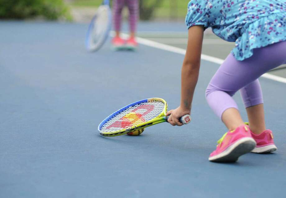 A child stops the tennis ball during 15-LOVE's first summer session in Upper Lincoln Park on Monday, June 29, 2015 in Albany, N.Y. (Olivia Nadel/ Special to the Times Union) Photo: ON / 00032397A