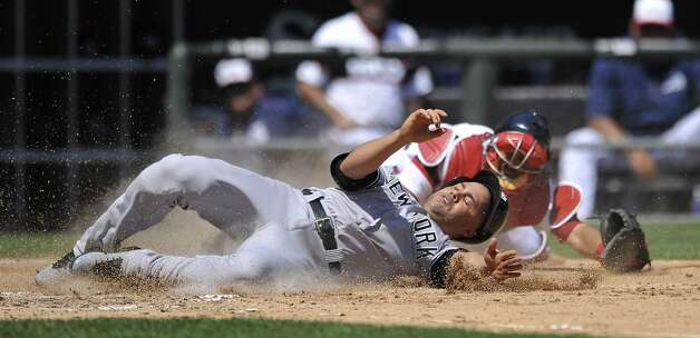 New York Yankees' Carlos Beltran, front, slides safely into home plate on a Didi Gregorius single as Chicago White Sox catcher Geovany Soto tries to apply the tag during the fourth inning of a baseball game Sunday, Aug. 2, 2015, in Chicago. (AP Photo/Paul Beaty) ORG XMIT: CXS103 Photo: Paul Beaty / FR36811 AP
