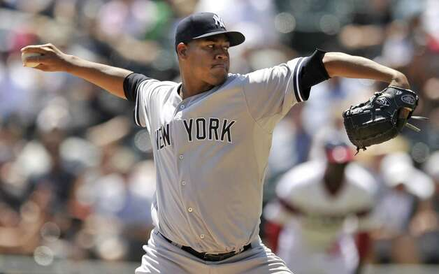 New York Yankees starter Ivan Nova delivers a pitch during the first inning of a baseball game against the Chicago White Sox Sunday, Aug 2, 2015 in Chicago. (AP Photo/Paul Beaty) ORG XMIT: CXS102 Photo: Paul Beaty / FR36811 AP