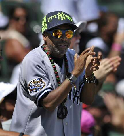 Director Spike Lee celebrates after New York Yankees' Brian McCann and Carlos Beltran scored on a Didi Gregorius single during the fourth inning of a baseball game against the Chicago White Sox, Sunday, Aug. 2, 2015, in Chicago. (AP Photo/Paul Beaty) ORG XMIT: CXS105 Photo: Paul Beaty / FR36811 AP