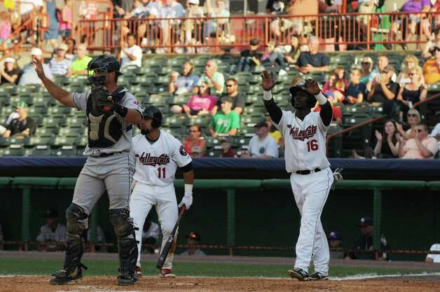 Hector Roa watches a teammate run to home base after he scored during the fifth inning of the Tri-City ValleyCats game against the Mahoning Valley Scrappers on Sunday, August 2, 2015, in Troy, N.Y. (Olivia Nadel/ Special to the Times Union) Photo: ON / 00032769A