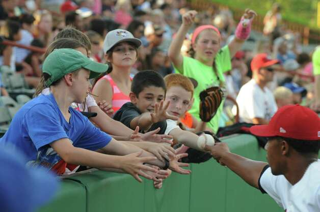 ValleyCats Dexture McCall hands fans a baseball between the fifth and sixth innings of the Tri-City ValleyCats game against the Mahoning Valley Scrappers on Sunday, August 2, 2015, in Troy, N.Y. (Olivia Nadel/ Special to the Times Union) Photo: ON / 00032769A