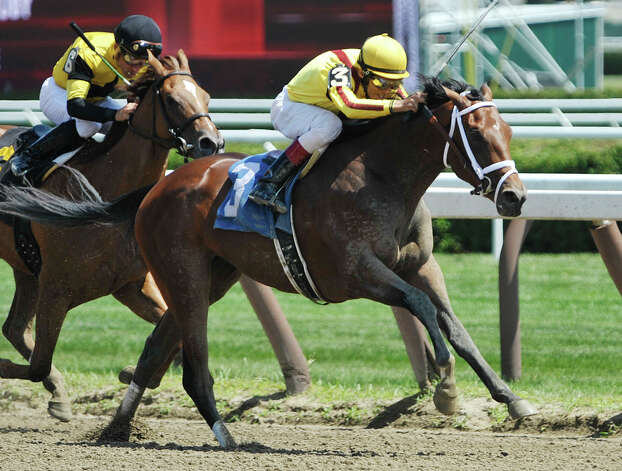 Rachel's Valentina and jockey John Velazquez make their way to the finish line for a first place in the second race at the Saratoga Race Course on Sunday, August 2, 2015, in Saratoga Springs, N.Y.     (Paul Buckowski / Times Union) Photo: PAUL BUCKOWSKI / 10032858A
