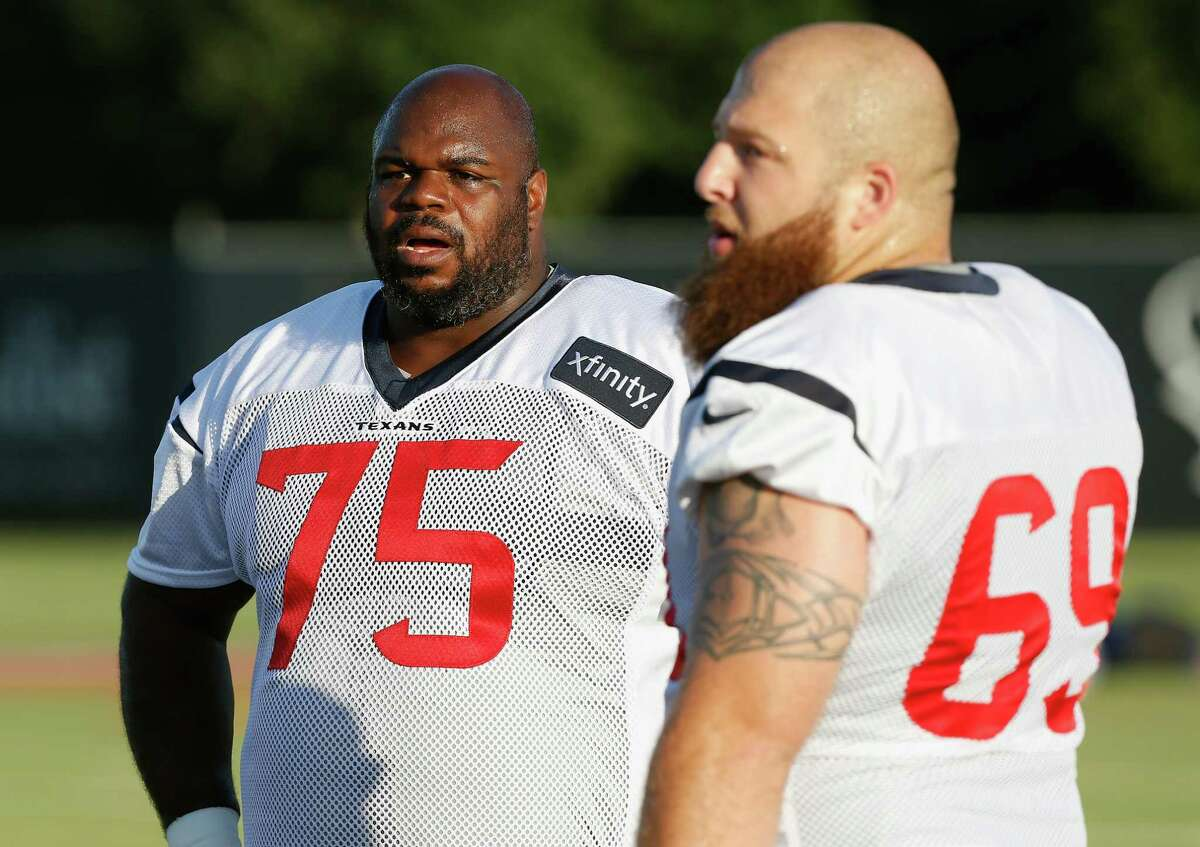 Houston Texans defensive tackle Vince Wilfork (75) and Chris Nield (69) during an NFL football training camp at the Methodist Training Center on Saturday August 1, 2015 in Houston, Texas. (AP Photo/Bob Levey)