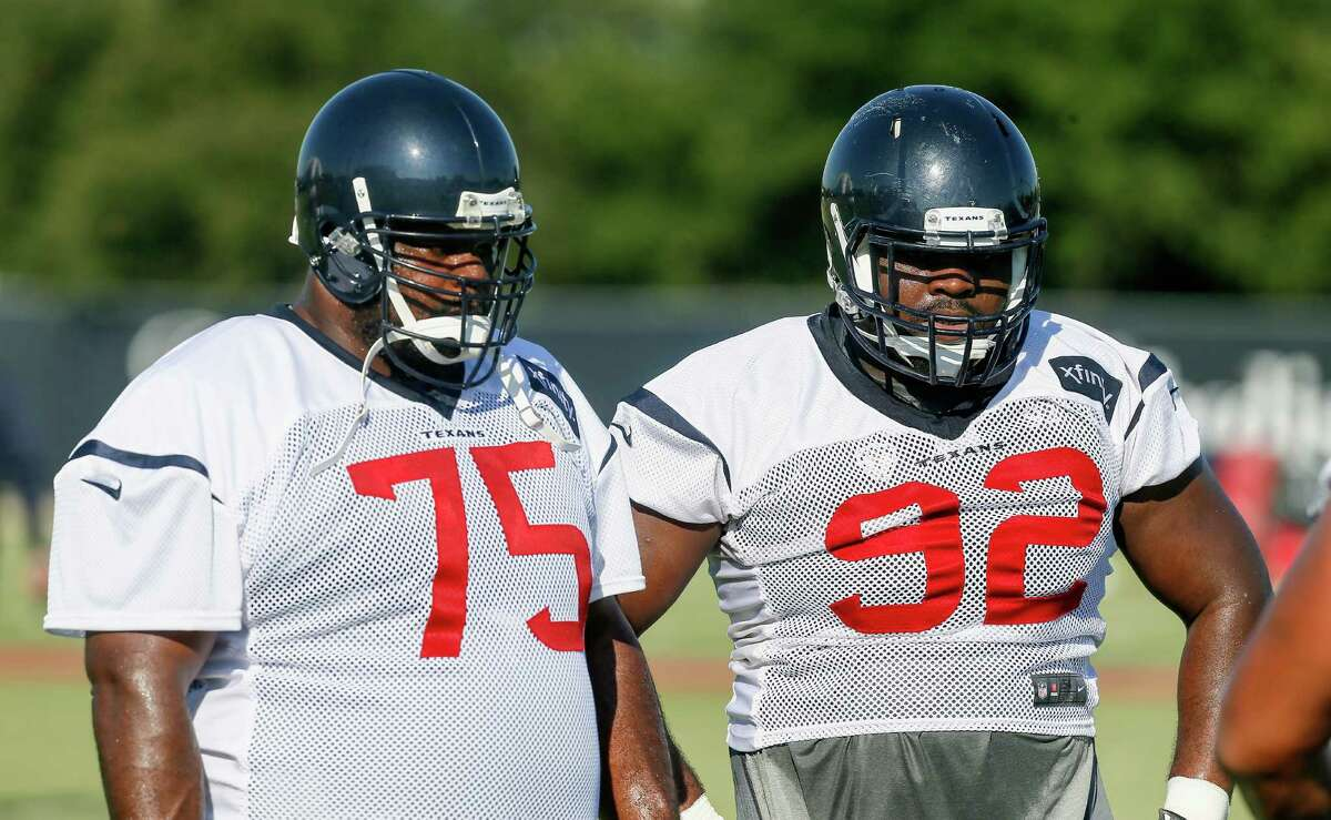 Houston Texans defensive tackle Vince Wilfork (75) and defensive tackle Louis Nix III (92) listen to instructions during NFL football training camp at the Methodist Training Center on Sunday, Aug. 2, 2015, in Houston. (AP Photo/Bob Levey)