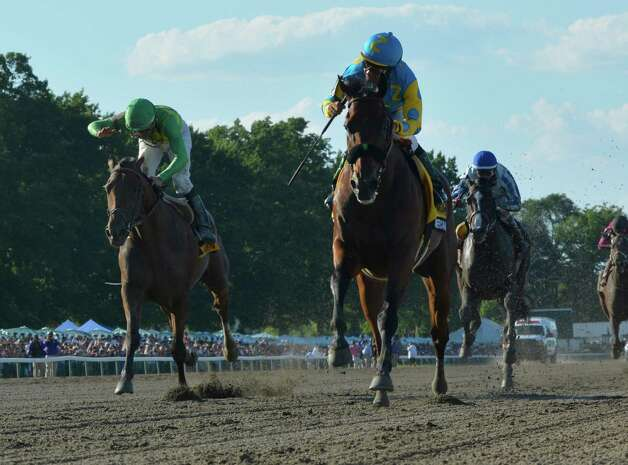 Triple Crown winner American Pharoah with jockey Victor Espinoza flies across the track  Sunday Aug. 2, 2015 at Monmouth Park in Oceanport, N.J. on his way to an easy win in the 48th running of The Haskel Invitational.    (Skip Dickstein/Times Union) Photo: SKIP DICKSTEIN