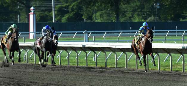 Triple Crown winner American Pharoah with jockey Victor Espinoza puts a significant distance between himself and the rest of the field Sunday Aug. 2, 2015 at Monmouth Park in Oceanport, N.J. on his way to an easy win in the 48th running of The Haskel Invitational.    (Skip Dickstein/Times Union) Photo: SKIP DICKSTEIN