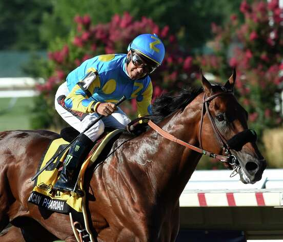 Triple Crown winner American Pharoah with jockey Victor Espinoza finishes the race with a very happy jockey Sunday Aug. 2, 2015 at Monmouth Park in Oceanport, N.J. after his easy win in the 48th running of The Haskel Invitational.    (Skip Dickstein/Times Union) Photo: SKIP DICKSTEIN