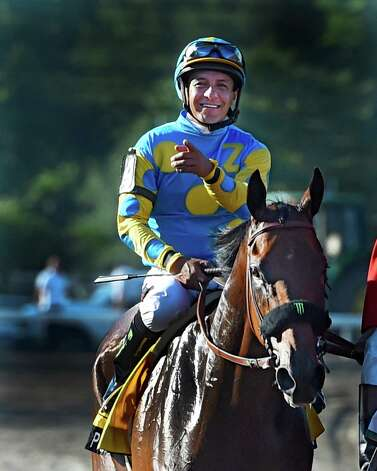 Jockey Victor Espinoza is jubilant Sunday Aug. 2, 2015 at Monmouth Park in Oceanport, N.J. after Triple Crown winner American Pharoah's easy win in the 48th running of The Haskel Invitational.    (Skip Dickstein/Times Union Photo: SKIP DICKSTEIN