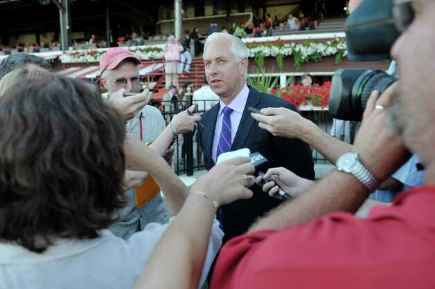 Trainer Todd Pletcher talks to members of the media after the horse he trains, Stop Charging Maria, placed first in the tenth race at the Saratoga Race Course on Sunday, August 2, 2015, in Saratoga Springs, N.Y.   (Paul Buckowski / Times Union) Photo: PAUL BUCKOWSKI / 10032858A