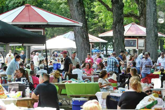People enjoy the afternoon in the picnic area at the Saratoga Race Course on Sunday, August 2, 2015, in Saratoga Springs, N.Y.   (Paul Buckowski / Times Union) Photo: PAUL BUCKOWSKI / 10032858A