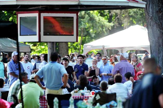 Racing fans watch the fifth race on a monitor in the picnic area at the Saratoga Race Course on Sunday, August 2, 2015, in Saratoga Springs, N.Y.  (Paul Buckowski / Times Union) Photo: PAUL BUCKOWSKI / 10032858A