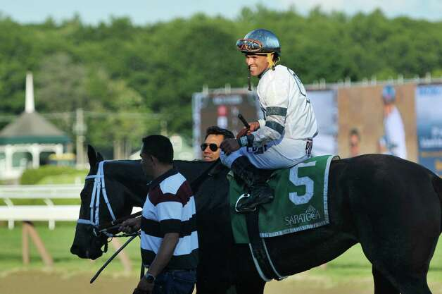 Jockey Javier Castellano rides Stop Charging Maria to the winners circle after winning the tenth race at the Saratoga Race Course on Sunday, August 2, 2015, in Saratoga Springs, N.Y.   (Paul Buckowski / Times Union) Photo: PAUL BUCKOWSKI / 10032858A