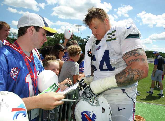Buffalo Bills guard Richie Incognito (64) signs autographs during NFL football training camp in Pittsford, N.Y., Sunday, Aug. 2, 2015. (AP Photo/Bill Wippert) ORG XMIT: NYBW103 Photo: Bill Wippert / FR170745 AP