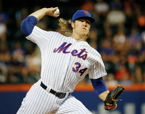 New York Mets starting pitcher Noah Syndergaard delivers in the first inning of  a baseball game against the Washington Nationals in New York on Sunday, Aug. 2 2015. (AP Photo/Kathy Willens) ORG XMIT: NYM101 Photo: Kathy Willens / AP