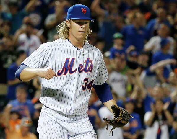 New York Mets starting pitcher Noah Syndergaard reacts after pitching through eight innings of the Mets 5-2 victory over the Washington Nationals during a baseball game in New York, Sunday, Aug. 2, 2015. (AP Photo/Kathy Willens) ORG XMIT: NYM114 Photo: Kathy Willens / AP