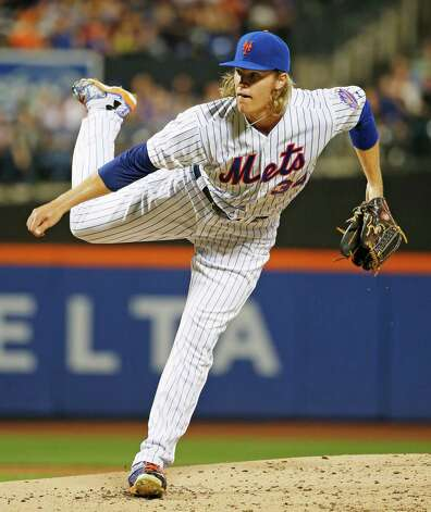 New York Mets starting pitcher Noah Syndergaard delivers during the second inning of a baseball game against the Washington Nationals in New York, Sunday, Aug. 2, 2015. (AP Photo/Kathy Willens) ORG XMIT: NYM112 Photo: Kathy Willens / AP