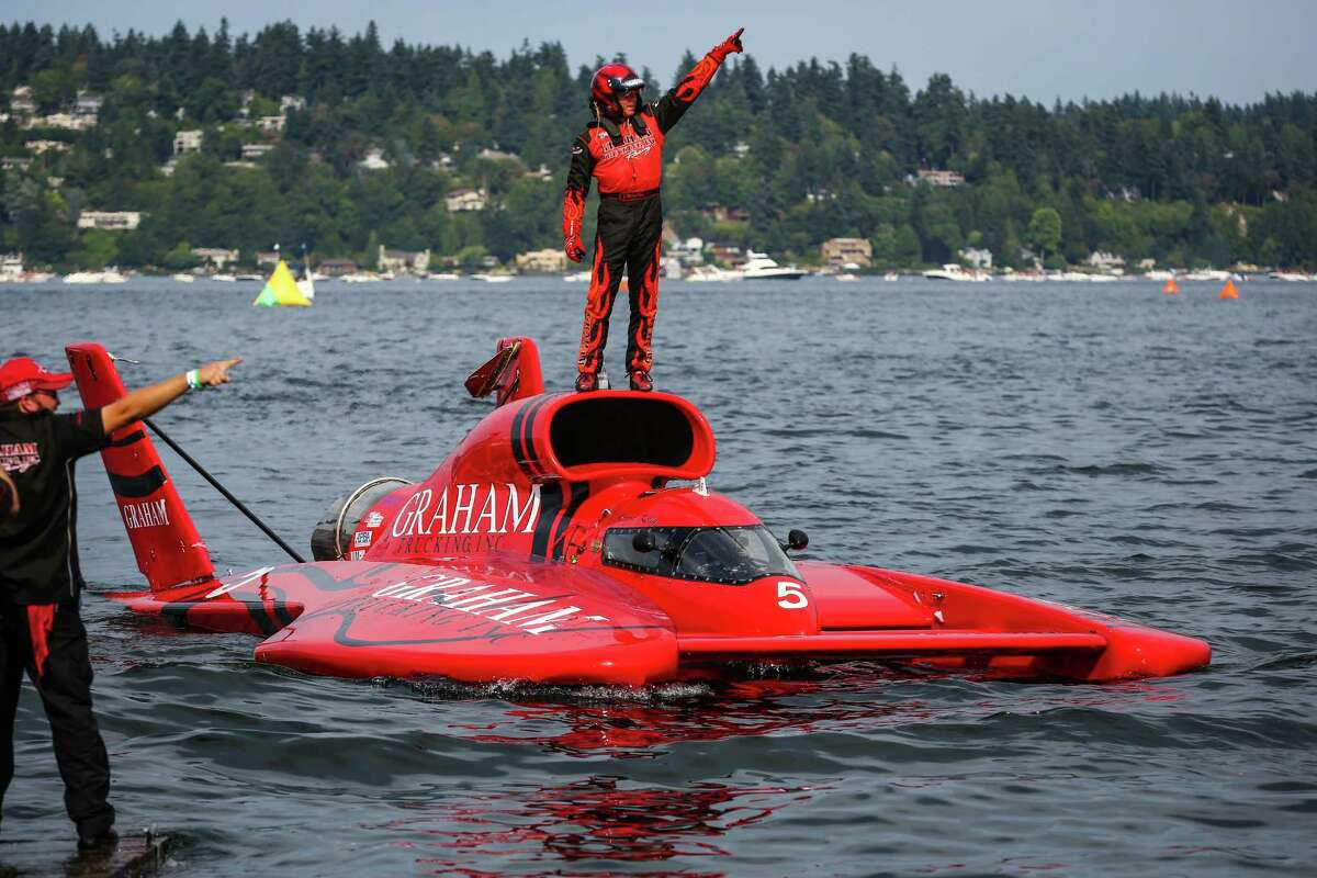 J. Michael Kelly celebrates his win of the Albert Lee Cup at Seafair while pulling into the dock on the U-5 Graham Trucking hydroplane during Seafair 2015. Seafair, the traditional summer Seattle festival, brings hydroplane boats to Lake Washington and aircraft to the skies above for the weekend's Boeing Air Show. Photographed on Sunday, August 2, 2015.