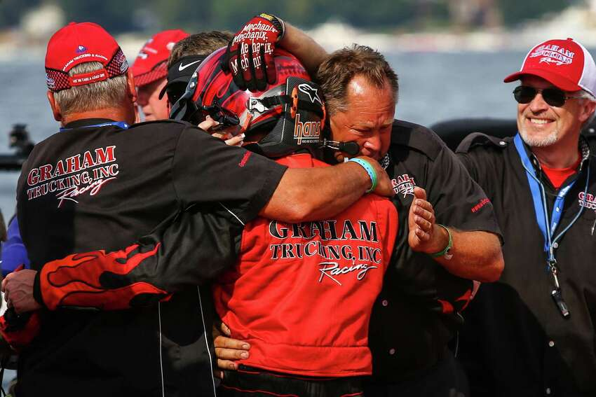 Teammates hug J. Michael Kelly after his win of the Albert Lee Cup at Seafair in the U-5 Graham Trucking during Seafair 2015. Seafair, the traditional summer Seattle festival, brings hydroplane boats to Lake Washington and aircraft to the skies above for the weekend's Boeing Air Show. Photographed on Sunday, August 2, 2015.