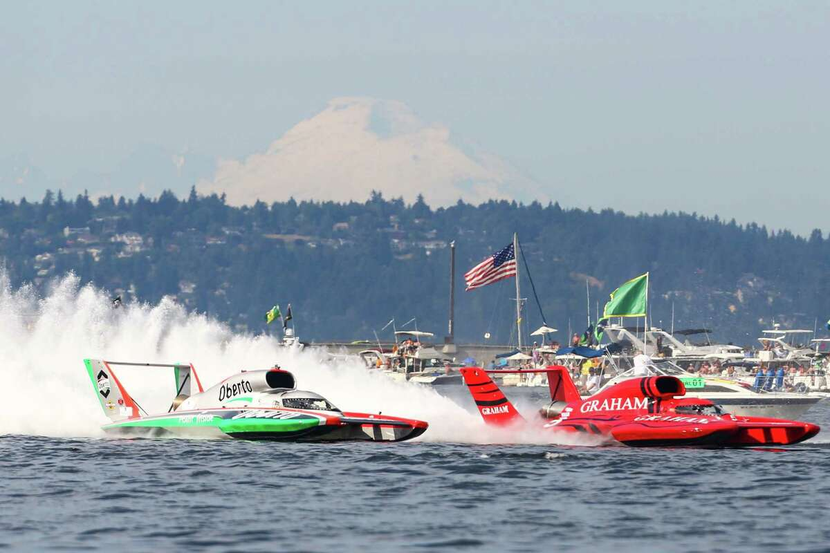 The U-1 Oberto and the U-5 Graham Trucking have a fierce battle for the lead in the championship race during Seafair 2015. Oberto was penalized during the race and the Graham Trucking boat won the race. Seafair, the traditional summer Seattle festival, brings hydroplane boats to Lake Washington and aircraft to the skies above for the weekend's Boeing Air Show. Photographed on Sunday, August 2, 2015.