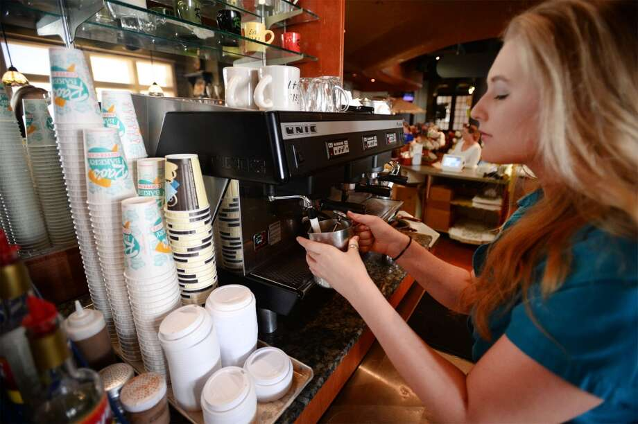 Kelsey Craig prepares an iced latte at Rao's in Beaumont.  Photo taken Monday, July 20, 2015 Guiseppe Barranco/The Enterprise Photo: Guiseppe Barranco/The Enterprise