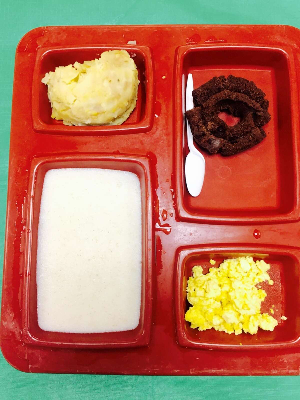 San Francisco Jail Food Served at 4 a.m., this is sweetened farina, scrambled eggs, Lyonnaise potatoes (presumably originating in the Lyon region of France) and a donut.