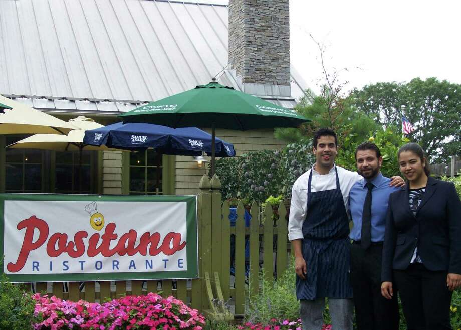 Positano's restaurant has reopened on Powers Court, next to the Westport Country Playhouse. Shown in the photo are: (from left to right) Chef Fernando Scarpati, Manager Gianni Rizzi and Assistant Manager Aida Scarpati. Photo: Anne M. Amato / Hearst Connecticut Media / Westport News