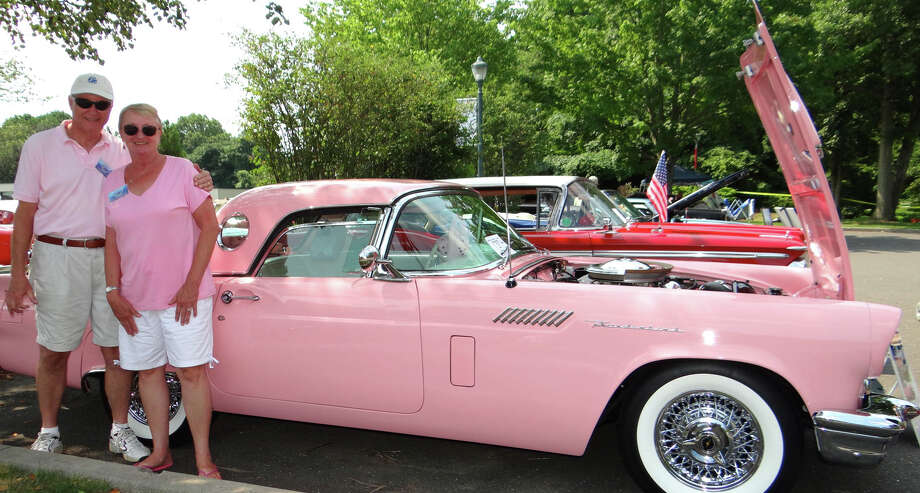 In the Pink: Bill and Susan Bachlechner match the distinctive color of their 1957 Ford Thunderbird at the Connecticut Seaport Car Club's Antique and Classic Car Show on Saturday at Fairfield University. Photo: Mike Lauterborn / For Hearst Connecticut Media / Fairfield Citizen