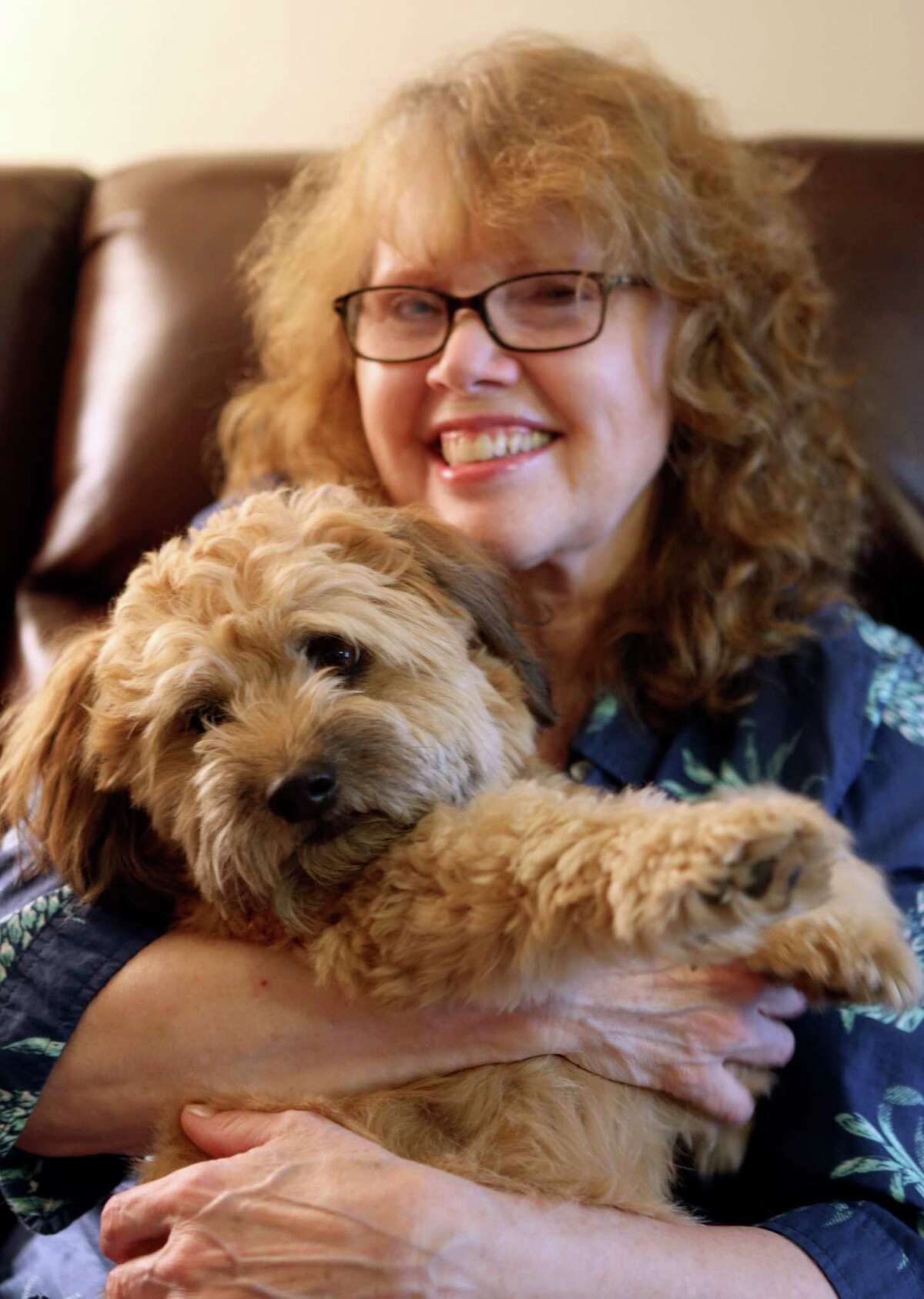 Janis Reumann often hears how she and her rescue dog Boog look alike.