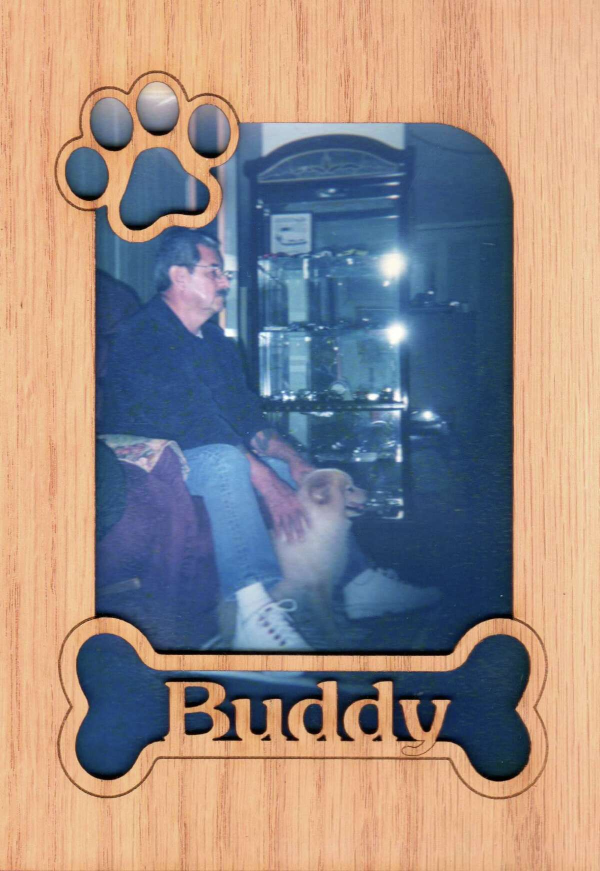 Manuel P. Munoz with his late dog Buddy.